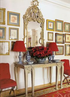 red white and blue_home_entry way gold mirror gallery wall red chairs rug lamp shades