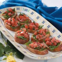 Tomato Basil Bruschetta. For school we left out red pepper and pimento. Chopped all of basil and added in, did not measure, just tasted. We toasted bread with oil and garlic powder. We left topping off and served on the line to the kids that wanted it. Delicious!