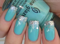 "My base was China Glaze For Audrey -- a Tiffany blue of course. My tips were covered with ""diamond-like"" OPI Crown Me Already"