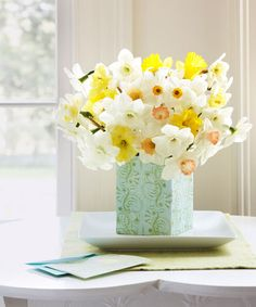 Turn a quartet of greeting cards into a sweet sleeve to slip over a vase. Start by dabbing a glue stick on the back of one of the cards. Affix that side to the interior of the front of another card; repeat with the remaining cards, sticking the final card in place.  - GoodHousekeeping.com