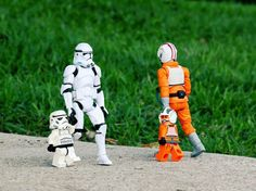 """I Love this photo! :stormtrooper: """"dont look son its that trouble maker rebel!"""" son stormtrooper: """" but he looks alright dad"""" :father stormtrooper: """" you see son... he kinda blew up my best friend bob, your mother and my workstation... i was so close to a raise.."""""""