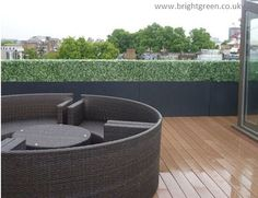 Artificial Boxwood hedging on a roof terrace in troughs creating a seamless length