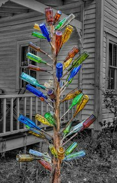 Bottle Tree, I have one mine is a cedar tree log I bought from a guy that has a saw mill.  I have varies types of bottles that are all cobalt blue.  I love it, friends and family love it too!  Everyone always enjoys looking at the different shapes!