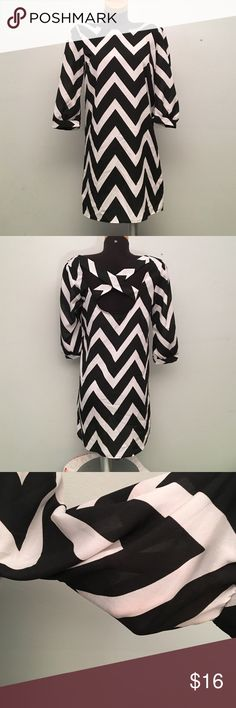 Charlotte Russe B&W Dress Crisscrossing detail on back. Semi sheer. 100% Polyester. Great condition! (B1) Charlotte Russe Dresses