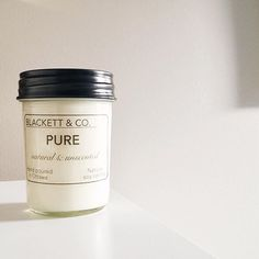 BLACKETT & CO.'s PURE candle, natural and unscented.