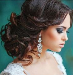 Loose and messy updo for long hair, with curls.
