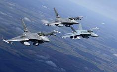 "General Dynamics F-16 ""Fighting Falcon"" & McDonnell-Douglas F/A-18 ""Hornet""."