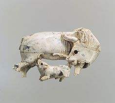 Plaque fragment with a cow and suckling calf  Period: Neo-Assyrian  Date: ca. 9th–8th century B.C.  Geography: Mesopotamia, Nimrud (ancient Kalhu)  Culture: Assyrian  Medium: Ivory