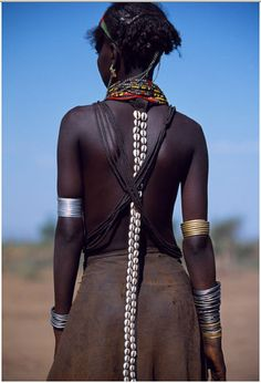 Love the open back and cowry shell accessory. Ethiopian dassancech girl