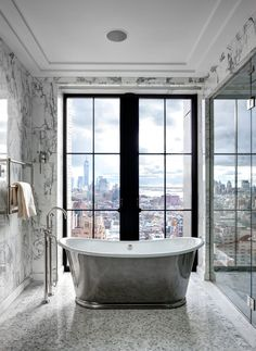 With walls made of glass, the bathrooms in the penthouse apartments of new Manhattan towers leave little to the imagination. But only the birds will get an eyeful.
