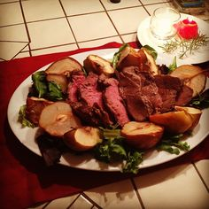 Main Course: Roast Beef with pears and fresh herbs.