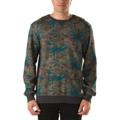 The Davenport Crew Fleece, made of 80% cotton/20% polyester, is a 285gm French terry crew neck fleece with all-over tropical camo print and Vans woven label at the hem. Model is 6' and wearing a size M