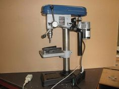 Thread Tapping Machine by markfuga -- Homemade thread tapping machine comprised of a benchtop drill press retrofitted with a low RPM reversible motor. http://www.homemadetools.net/homemade-thread-tapping-machine