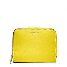 Coach :: Saffiano Leather Medium Zip Around. I cannot live without a yellow wallet. Just ask my husband.