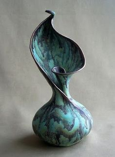 This vase reminds me of nature by the shape and color. Blue like water and the spiral like a flower before it blooms. Artist: Susan Anderson Title: Growth Series