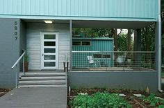 Shipping container home ideas and designs, mixed metals and blue grey tones.