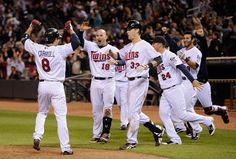 The Minnesota Twins celebrate a three run home run by Josh Willingham #16 to walk off in the ninth inning against the Oakland Athletics on May 29, 2012 at Target Field in Minneapolis, Minnesota. The Twins defeated the Athletics 3-4 in a walk-off