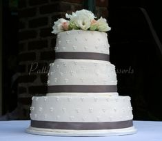 Simple wedding cake with gray ribbon and beautiful flowers