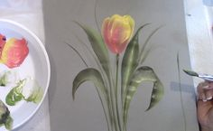 April Numamoto shows you how to paint a Tulip using Plaid Folk Art Acylic Paints using the fun and easy One Stroke painting method. You can contact April at ...