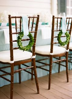 mini wreaths on backs of chairs