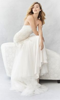 Style BE357, Ella Rosa Embellished strapless sweetheart wedding dress with panelled plunging neckline and tulle skirt.