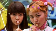 "TOKYO, JAPAN:  Eighteen-year-old student Yoko Sasaki (R) and her classmate Anna Shimasaki (L) pose for pictures on a street at Tokyo fashion district Harajuku, 17 June 2000.  Fashion conscious Japanese girls, referred to as ""kogyaru"" in Japanese, often shape the future of fashion with their shopping patterns and dressing styles.      (ELECTRONIC IMAGE)   AFP PHOTO/Toru YAMANAKA (Photo credit should read TORU YAMANAKA/AFP/Getty Images)"