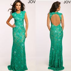 Jovani 23412. Stunning lace form fitting green gown features an open back and crystal embellishments. Available in Green, Black and Champagne.