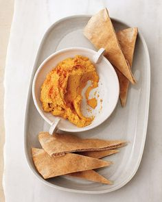 Sweet Potato Hummus. 1 pound sweet potatoes, peeled and cut into 1-inch pieces 1 can (19.5 ounces) chickpeas, drained and rinsed 1/4 cup fresh lemon juice (from 1 lemon) 1/4 cup tahini 2 tablespoons olive oil 2 teaspoons ground cumin 1 garlic clove, chopped Coarse salt and ground pepper Whole-wheat pita and crudites such as red pepper and broccoli
