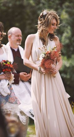 love the colors in the bouquets!  looks like a fall wedding to me!