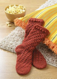 Learn to Crochet Socks for the Family - So comfy and soft, hand-crocheted socks are one of life's ultimate luxuries! Crochet expert Darla Sims presents 15 cozy toe-warmers for the family and also teaches you how to design your own. There are socks and slipper socks for children, women, and men. From anklets to add-on ribbing socks, top-down socks to sports socks, the varying styles offer something to please everyone. The stitch patterns are fun, too, and include shells, lace designs, and ...