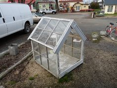 Tiny Greenhouse, recycles old windows