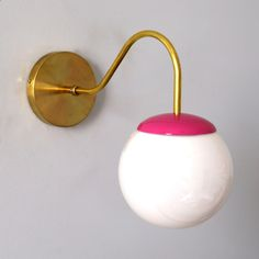 Mid Century modern pink and brass wall sconce with white glass globe.  Perfect for bathrooms, bedrooms, kids bedrooms, and more. Sconces Living Room, Wall Sconces, Sputnik Chandelier, Sconce Lighting, Glass Globe, 50 Shades, Plates On Wall, Modern Lighting, Glass Shades