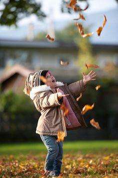 Amelia throwing leaves by Kim_Reimer, via Flickr