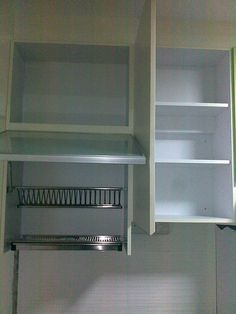Put Dish Drainer In Cabinet Over Sink. Use Pull Out And Slide Back Doors.