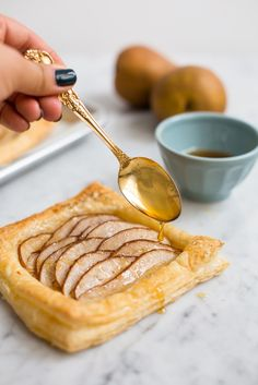 I made these apple tarts awhile ago and still to this day I still think they are one of the easiest desserts to make. I was in need of a quick dessert solution the other day so I tried this again but with pears and honey – I am completely addicted. I used no refined sugar in this version but the sweetness of the pear and the honey on top makes the perfect sweetness combo in my mind.