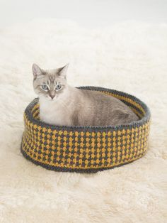 Knit a Pretty Kitty Bed for your feline friend! Your cat will love having a cozy place to sleep, and you can make it in colors that complement your decor! Pattern calls for 4 balls of Hometown USA in main color, 2 in accent color, and size 9 knitting needles.