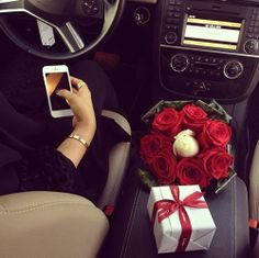 A nice set: car with a cream colour inside, a white iphone, roses and a present from Cartier - what more could a girl want.