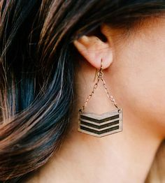 Go bold with a military inspired chevron earring set. The crisp hand-drawn chevron pattern is engraved into beautifully rich walnut for a statement earring. Give that flowing boho dress new life with these natural and modern earrings, why dontcha?