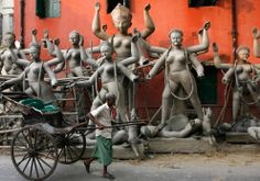 A rickshaw puller passes in front of unfinished idols of Hindu goddess Kali outside a workshop in the eastern Indian city of Kolkata. West Bengal Taxi r State, Rubiks Cube Patterns, Maa Durga Photo, Bengali Culture, Durga Painting, Navratri Wishes, Levitation Photography, Buddha Meditation, Indian Art Paintings, Durga Puja