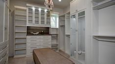 The finest clothes would beg not to be worn in order to reside in this gorgeous master closet all day! | The Reserve Parade Farmhouse