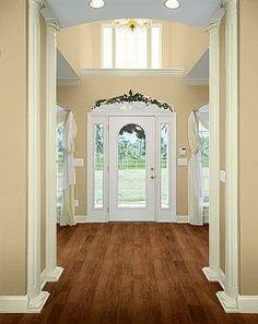dark flooring, light colored walls, white trim (living room, dining room)