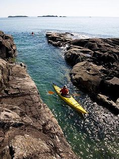 """Isle Royale National Park, Michigan """"You can hike on 165 miles of trails, kayak around the rocky shoreline (left) or take water taxis to remote campsites."""""""
