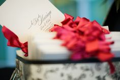 red white and black programs - real wedding photo by Seattle photographers GH Kim Photography