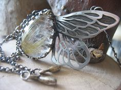 Golden Rutilated Quartz Wings Necklace by EyvindsAlchemy on Etsy https://www.etsy.com/listing/94924873/golden-rutilated-quartz-wings-necklace
