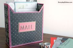 This decorative cereal box mailbox is an inexpensive way to avoid clutter and keep tabs on your mail.