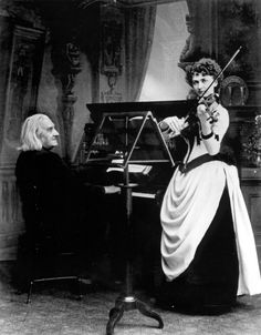 Franz Liszt (Hungarian, 1811-1886), seated, playing piano duet with violinist Arma Senkrah (American, 1865-1900) (c.1885).