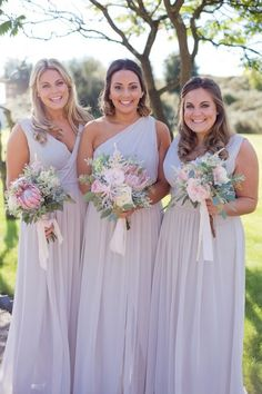 The grey bridesmaids' dresses. Click on the image to see our full gallery of this real wedding, which was a classic English celebration.