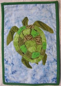 My idea: quilted Sea turtle baby play mat (shaped like turtle) This is the best example I could find so far.