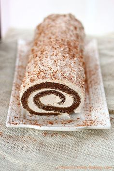 Moist gingerbread roll cake filled with spiced creamy filling from Roxanashomebaking.com