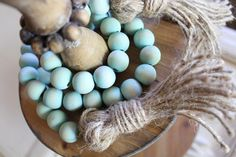 Wooden Beaded Garland with Jute Tassels - Hand Dyed Aqua / Blue - Farmhouse - Custom Home Decor by GracedHomeDesigns on Etsy https://www.etsy.com/listing/526143745/wooden-beaded-garland-with-jute-tassels